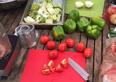 bell peppers, tomatoes, and onions on table