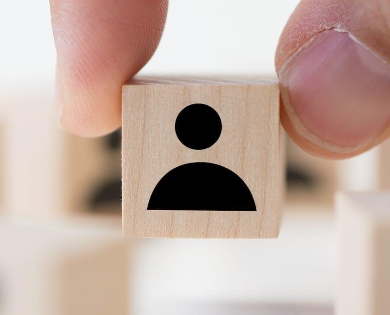 Job recruitment concept using icon people wood cube block